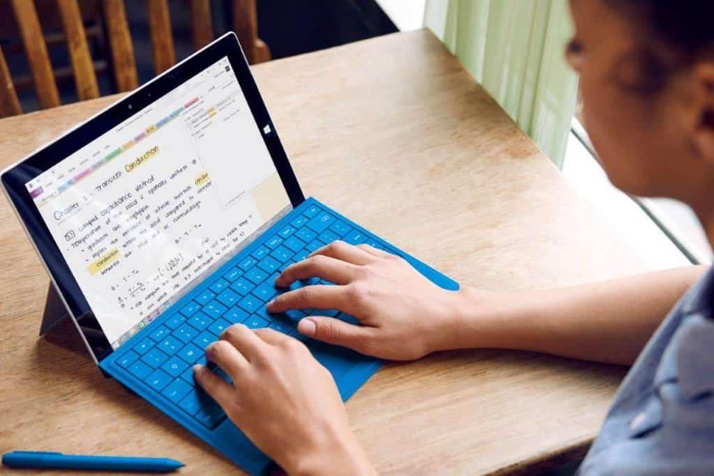 Person using a Microsoft Surface.